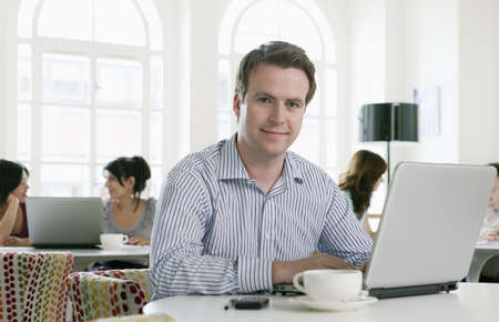 toils: Portrait of male with laptop LANG_EVOIMAGES