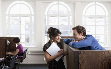 toils: Couple flirting in Business center LANG_EVOIMAGES