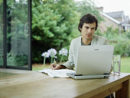 uses: Businessman talks on mobile phone