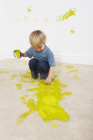 ravage: Boy sloshing paint onto carpet