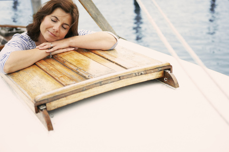 Middle aged woman on old boat