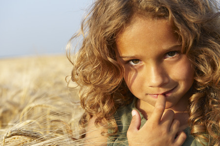 bashfulness: Girl in a wheat field LANG_EVOIMAGES