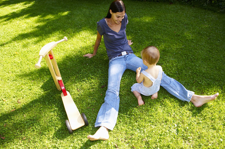 shoeless: Mother and son in the garden
