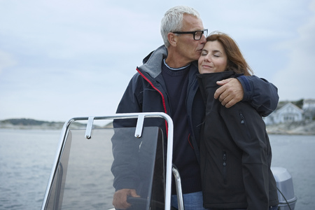 regard: Middle aged couple on motor boat LANG_EVOIMAGES