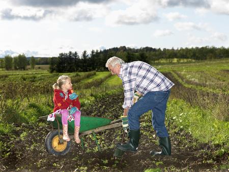 Grandfather shoveling dirt LANG_EVOIMAGES