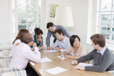 toils: Group of people at a conference table