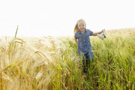 Girl running in a wheat field