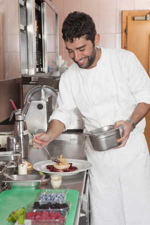 worked: cook preparing plate