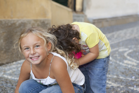 bashfulness: two children playing