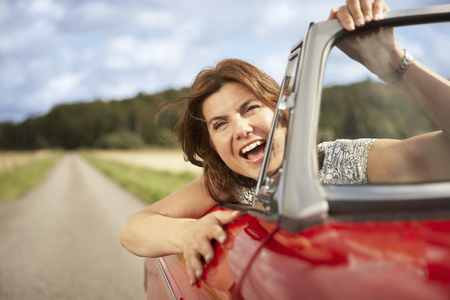 accelerated: Mid aged woman in sports car LANG_EVOIMAGES