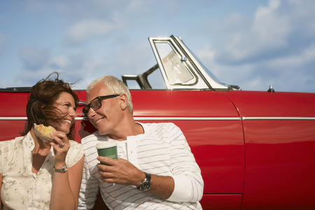 caffeine free: Couple with car, coffee break LANG_EVOIMAGES