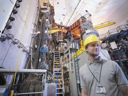 sciences: Scientist In Front Of Fusion Reactor