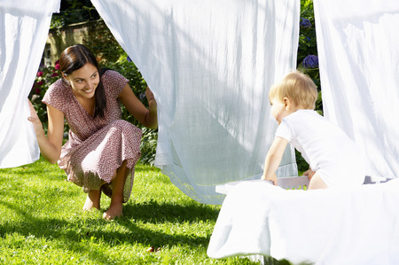 one sheet: Mother and son playing in the laundry