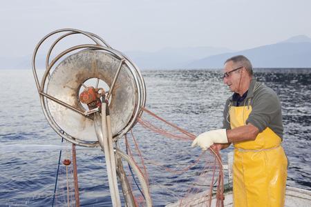 fisherman on boat, trawling