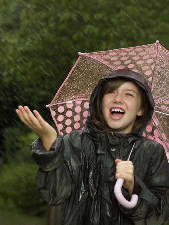 drizzling rain: Girl singling holding an umbrella