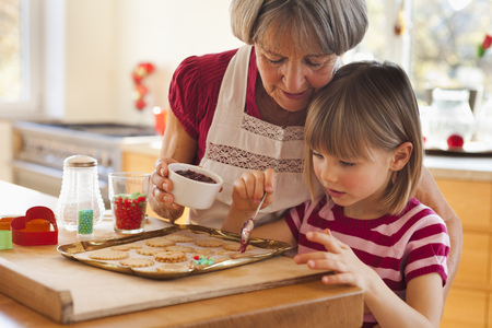 grandma and grandchild baking biscuits