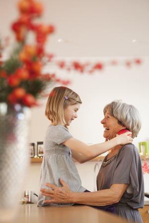 grandchild and grandma hugging LANG_EVOIMAGES
