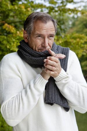 Middle aged man freezing