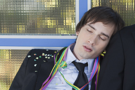 intoxicate: businessman after party, sleeping LANG_EVOIMAGES