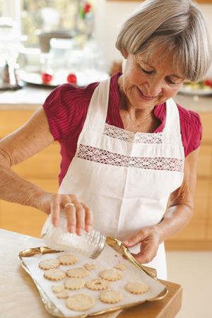 old woman preparing biscuits