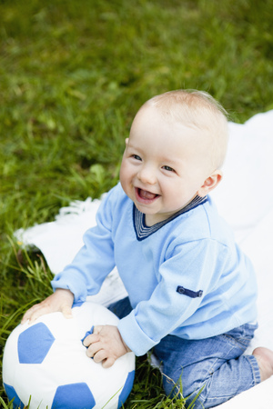 whimsy: baby boy with football LANG_EVOIMAGES