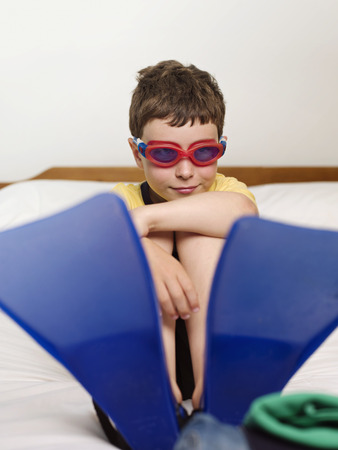 dressups: A boy wearing goggles and flippers