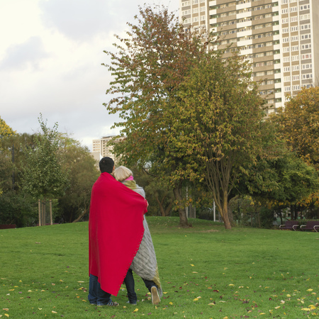 regard: couple with blankets in the park