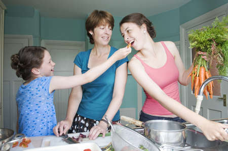 new age: Mother cooking with her two daughters LANG_EVOIMAGES