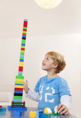 low spirited: boy with toy building blocks