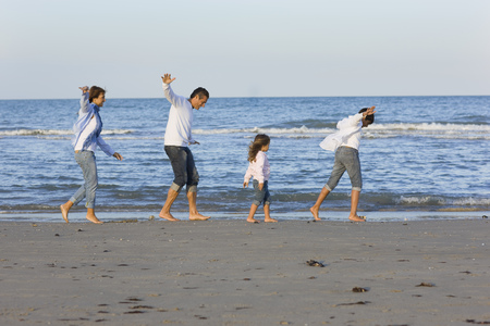leading light: Family on the beach.