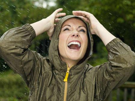 drizzling rain: A woman in the rain smiling