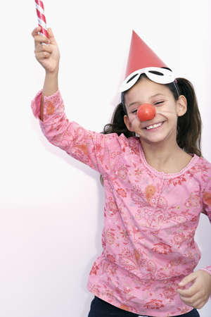 dressups: smiling girl playing with a blowpipe