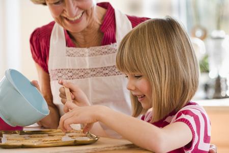 the elderly tutor: grandma and grandchild baking biscuits