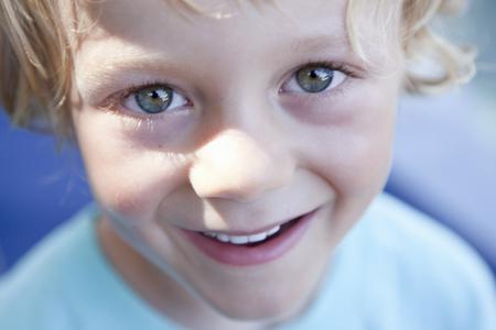rejoices: Portrait of boy smiling LANG_EVOIMAGES