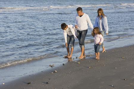 beachcombing: Family on the beach.