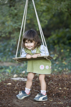 mischeif: Little girl playing on wood swing
