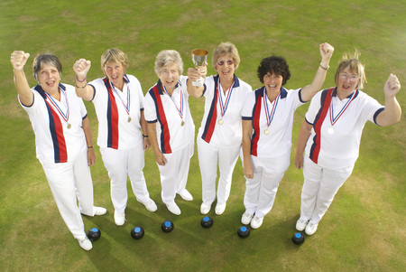prevailing: female bowls team and trophy