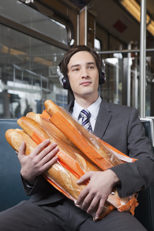 musically: businessman in tube with lot of bread