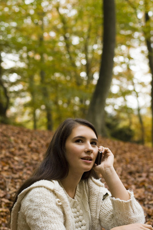 girl on phone in woods