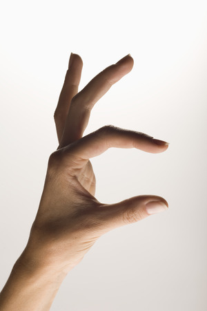 Hand measuring or indicating an object