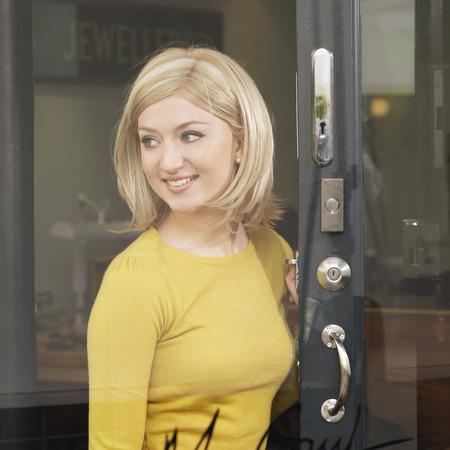 rotated: woman openingclosing door