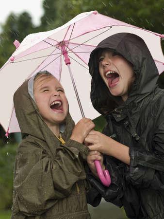 shrieking: Girls under an umbrella singing