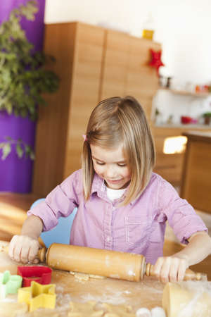 pin board: young girl rolling dough LANG_EVOIMAGES