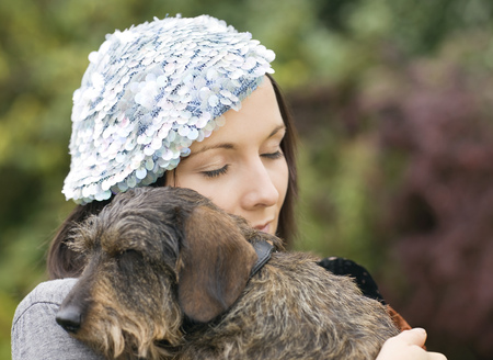 Portrait of woman embracing dog