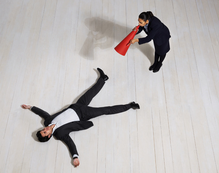 struggled: Business woman shouting at man on floor