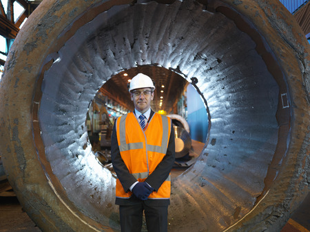 Engineer In Front Of Forged Steel LANG_EVOIMAGES