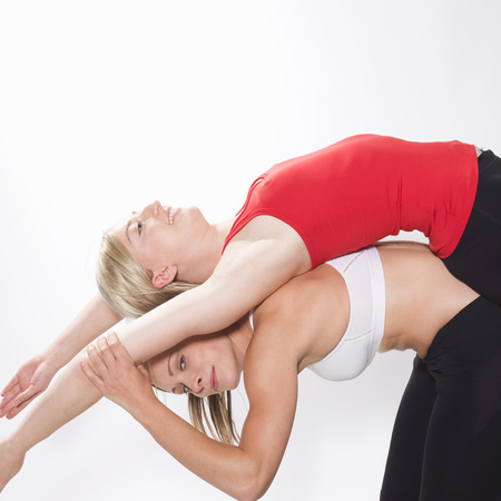 limber: 2 women stretching