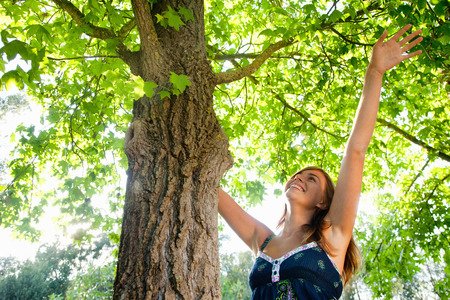 enthusiastically: Girl with a tree