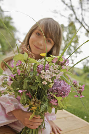new age: Little girl with a bouquet of flowers
