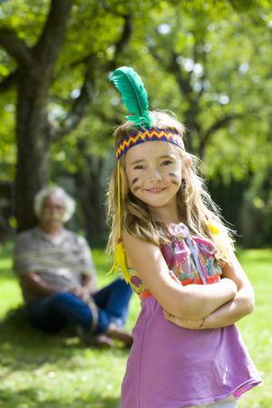 Costumed girl smiling LANG_EVOIMAGES